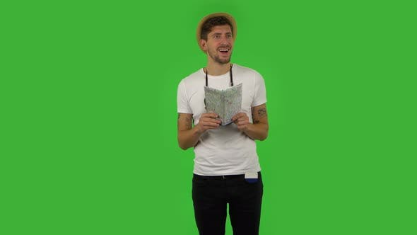 Thumbnail for Tourist with Map in Hand Is Looking Around and Saying Wow, Shocked Facial Expression. Green Screen