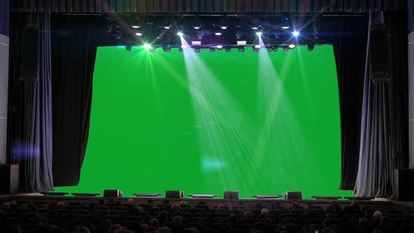 People Sit in the Auditorium and Look at the Green Screen
