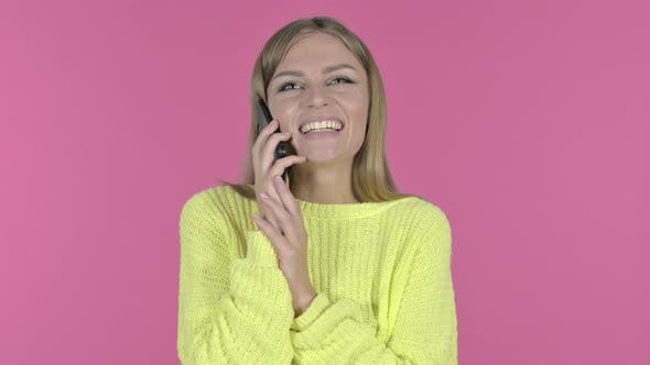 Thumbnail for Happy Young Girl Talking on Phone, Pink Background