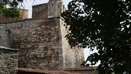 Walls of Baba Vida kaleto stronghold slow tilt 3840X2160 UltraHD tilting footage - Medieval fortress