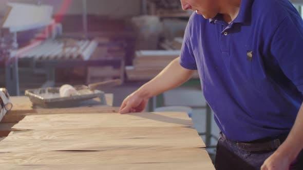 Applying paper-wood to wood board