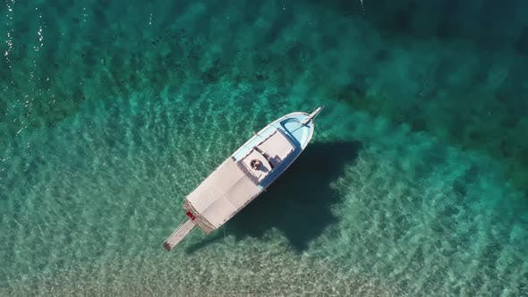 Beautiful Boat in the Clear Turquoise Sea