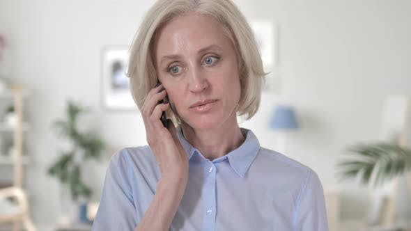 Thumbnail for Aged Woman Negotiating on Phone