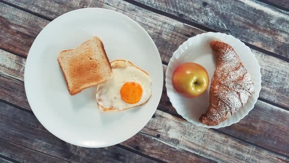 Thumbnail for Healthy Tasty Breakfast: Fried Egg, Toast, Apple and Croissant