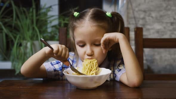 Thumbnail for Little Girl Child Eating Pasta At Home Kitchen