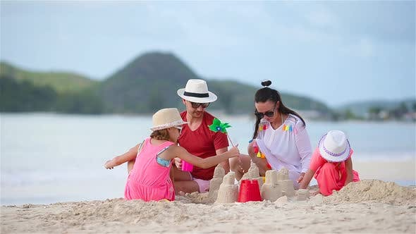 Thumbnail for Parents with Kids Play Making Sand Castle at Tropical White Beach