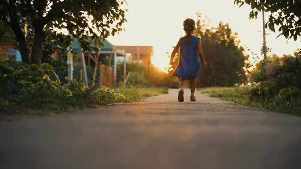 Thumbnail for Little Girl Child Playing And Having Fun Outdoor At Sunset