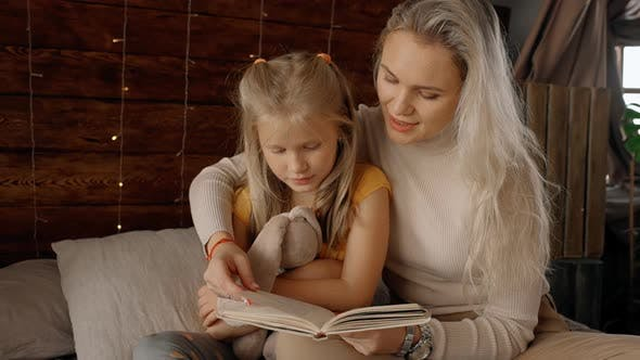 Thumbnail for Very Beautiful Mother Read Wonderful Fairytales To Little Charming Girl