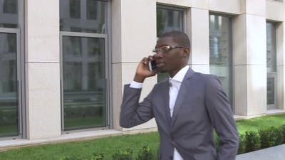 American Business Man Making a Mobile Phone Call - Black People