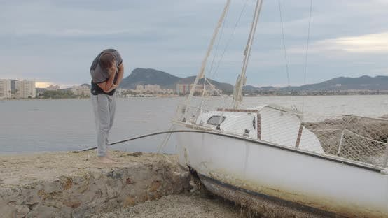 Thumbnail for Middle-aged Man Upset Near His of Broken Yacht. Insurance Case.