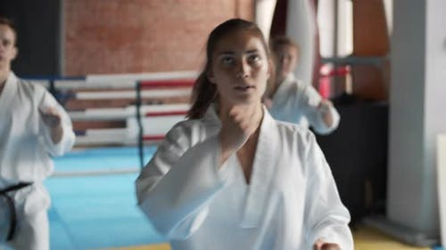 Female Trainer on Karate Classes with Beginners