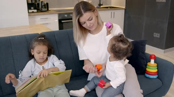 Young Mother Spending Time with Two Daughters