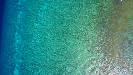 Thumbnail for Beautiful fly over tourism shot of a sandy white paradise beach and blue sea background in colorful