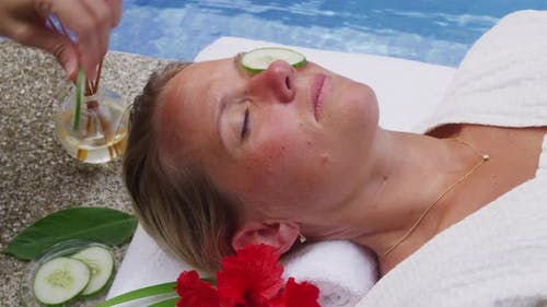 Woman at spa gets cucumbers put over eyes. Shot on RED EPIC for high quality 4K, UHD, Ultra HD resol