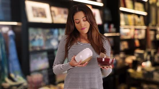 Thumbnail for Pretty Latin mom shopping for kitchenware inside store