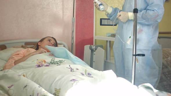 Thumbnail for Nurse in Mask and Gloves Preparing Female Patients for Dropper