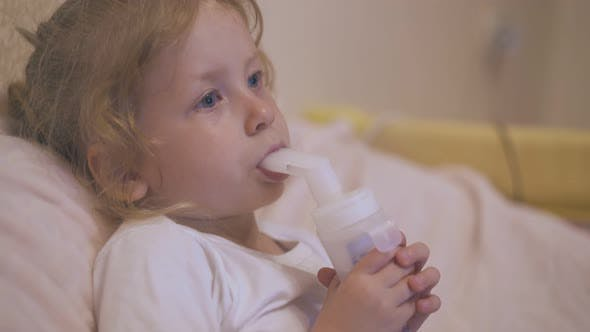 Upset Girl Breathes with Inhaler To Cure Cough in Bed