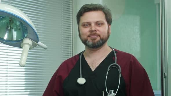 Confident Doctor Smiles Into Camera