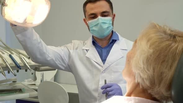 Thumbnail for Dentist Turns on the Dental Light