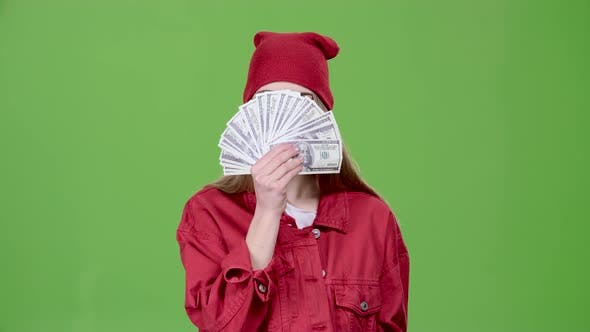 Thumbnail for Girl Is Holding Paper Money in Her Hands. Green Screen. Slow Motion