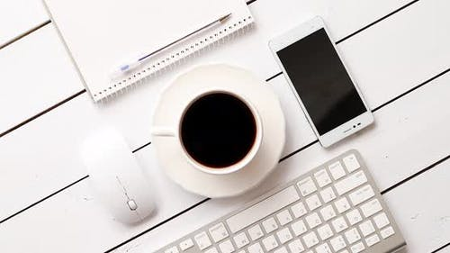 Devices and Stationery Near Hot Drink