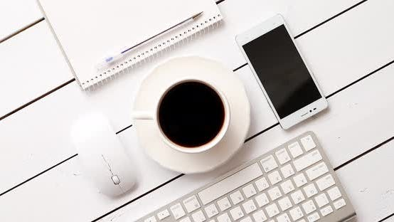 Cover Image for Devices and Stationery Near Hot Drink