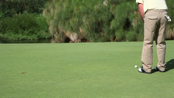 Thumbnail for Mature man playing golf, low section