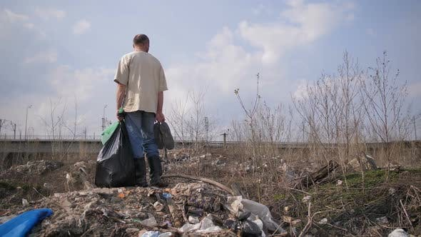 Thumbnail for Man Standing on Garbage Hill at Landfill Site