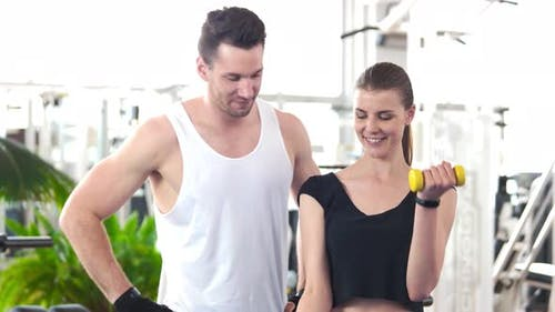 Woman Working Out with Personal Trainer.