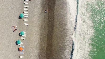 Cinematic View Tourist On The Beach In Batumi