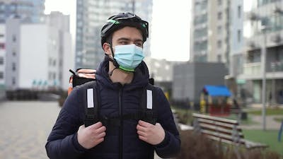 Masked Delivery Man Walking with Client's Order