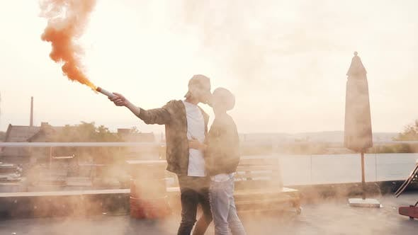 Cover Image for Young Man Kisses his Girlfriend Romantically on the Terrace