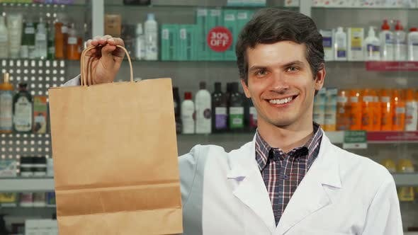 Thumbnail for Cheerful Pharmacist Holding Shopping Bag Smiling To the Camera 1080p