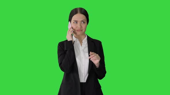 Thumbnail for Young Businesswoman Talking on Her Phone on a Green Screen, Chroma Key.
