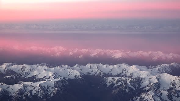 Pink Clouds Over The Mountain Range