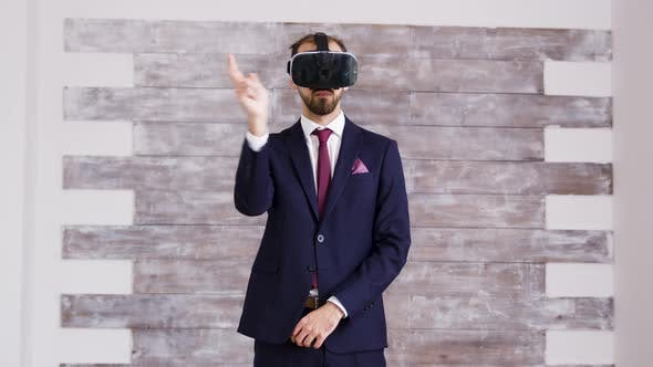 Thumbnail for Real Estate Agent in Business Suit Using Virtual Reality Googles