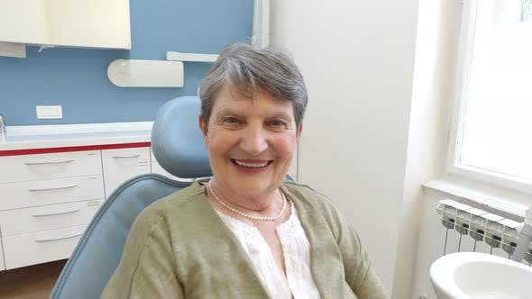 Thumbnail for Close up of happy elderly female patient at dentist