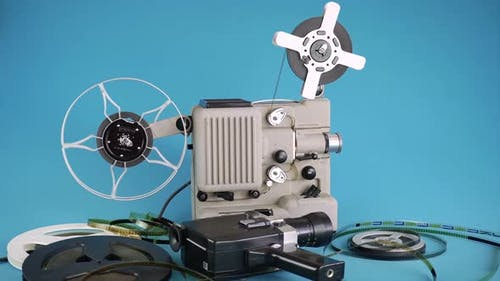 Home Video Viewing On A Vintage Movie Projector Filmed From A Movie Camera.