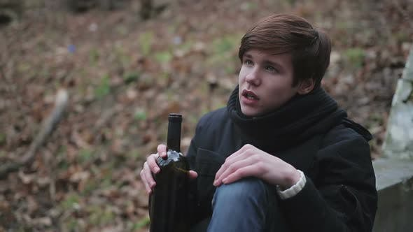 Hopeless Young Man Drinking Alcohol
