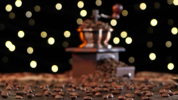Thumbnail for Grinder Filled with Coffee Beans and Cup on a Saucer