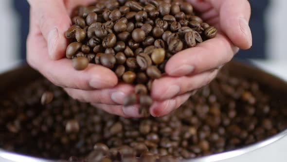 Cover Image for Man Taking Handful of Coffee Beans