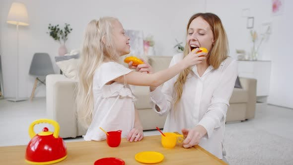 Thumbnail for Happy Mother and Daughter Playing Tea Party