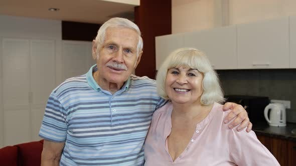 Thumbnail for Senior Couple Retired Grandparents Husband and Wife Happy Faces Embracing at Home, Hugging, Laughing