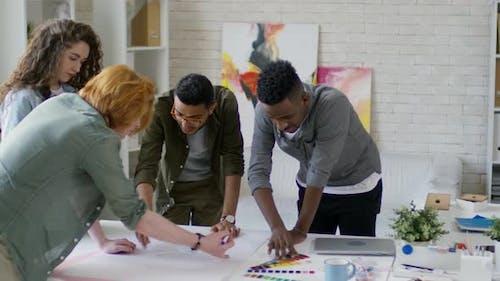 Four Design Professionals Brainstorming Together