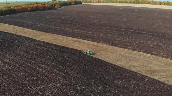A View of Fields - Tractors Plows the Field