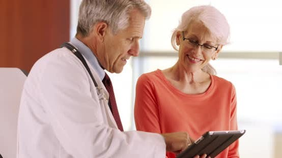 Thumbnail for Friendly senior doctor talking with elderly woman patient in the office