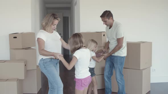 Thumbnail for Parents and Kids Celebrating Moving