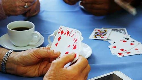 Senior friends playing cards at nursing home 4k