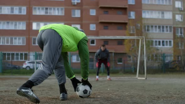Two Professional Soccer Athletes Training on Outdoor Field