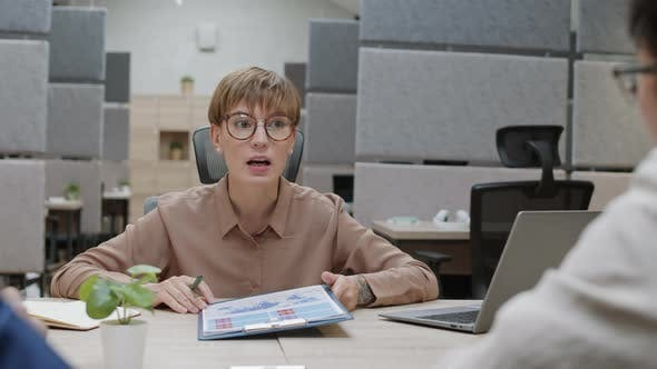Female CEO Having Meeting with Employees